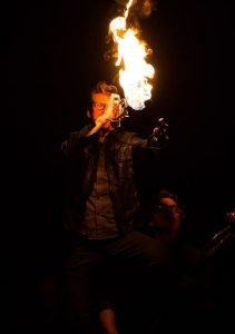 Billy Joe plays his flaming trumpet at Gimme Shelter